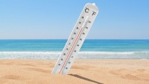 A thermometer on the beach near the sea to check the temperature